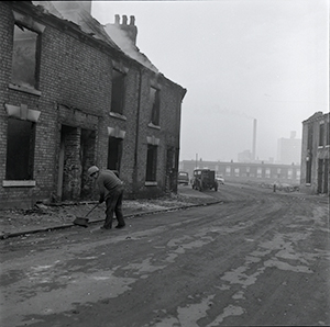 Photograph of houses in Hull being burned before demolition 1972,