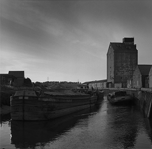 Black and white photograph of barges on the river Hull.