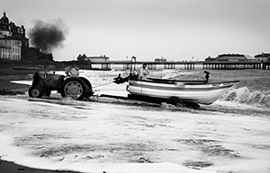 Photograph of fisherman launching