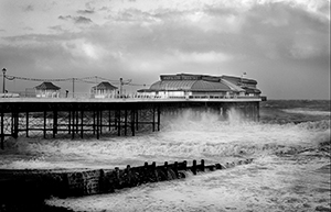 Photograph of Cromer pier in a storm.