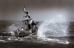 Photograph of boat being launched.