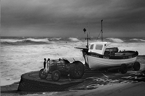 Photograph of a fishing boat in a strom in Cromer.