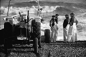 Photograph of fishermen, deciding it's too rough to go.