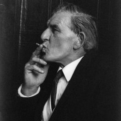 Black and white of a man with a cigarette