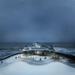 Photograph of a snow covered Cromer pier