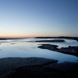 Photograph of incoming tide in the evening on Holkham sands.