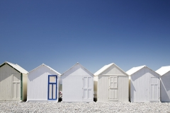 White beach huts Blue door - Normandy Coast