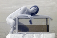 An infrared photograph of the dancer Louise Tanoto about to enter and aquarium on Cromer beach.
