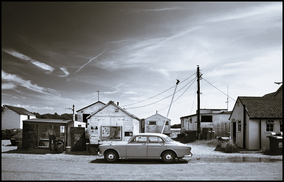 Photograph of old volvo car in what looks like an American setting.