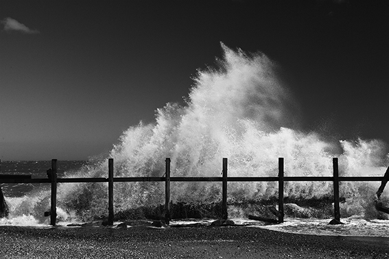 Black and white photograph of breaking waves.