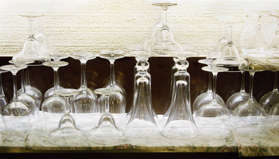 Photograph of glasses in bar.