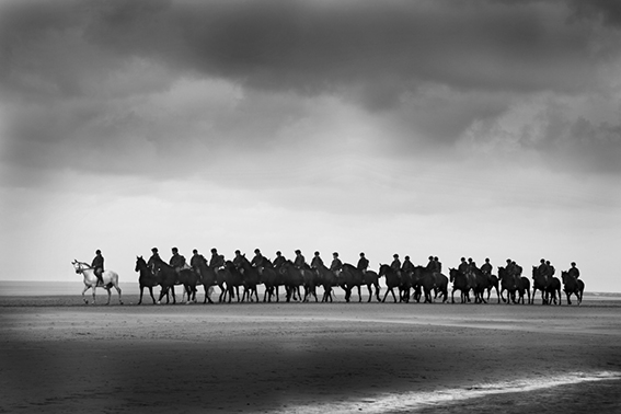 Black and white photograph of the Household Cavalry on Holkham sands Norfolk.