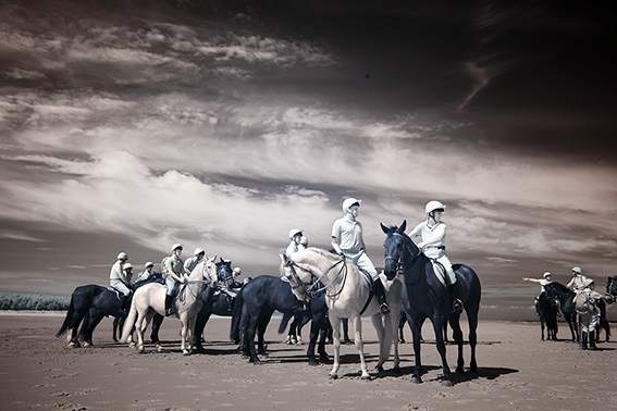 Infrared photograph of the Household Cavalry on Holkham sands Norfolk.