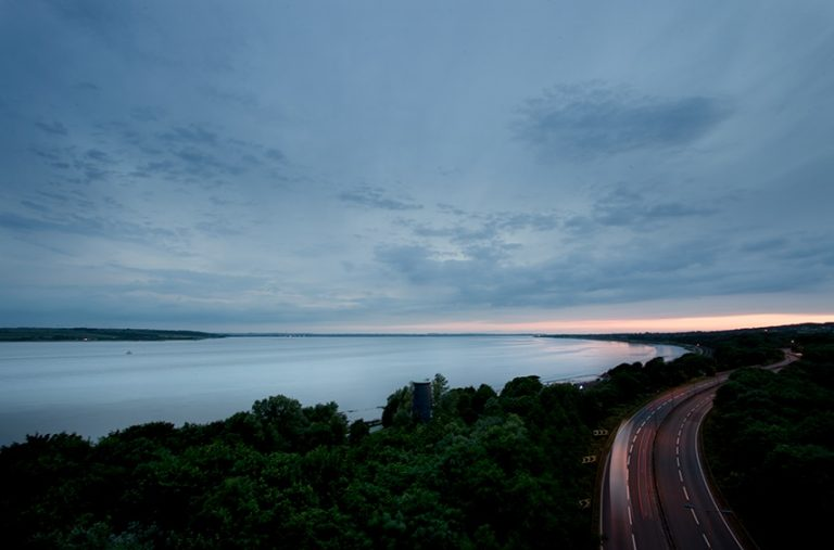 Photograph of the river Humber and the road next to it taken at dusk.