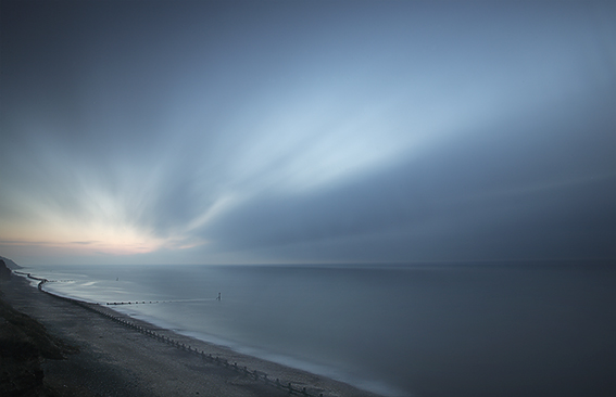 A long time sunset exposure of the sea along the Norfolk coast.