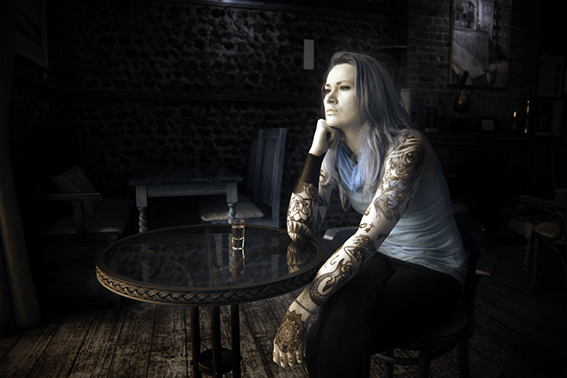 Infrared photograph of a girl with tattoos in a bar