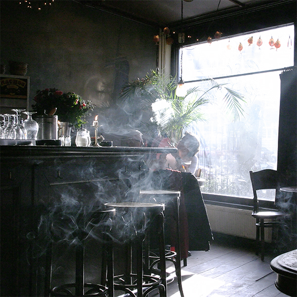 Photograph of a smoke filled bar.