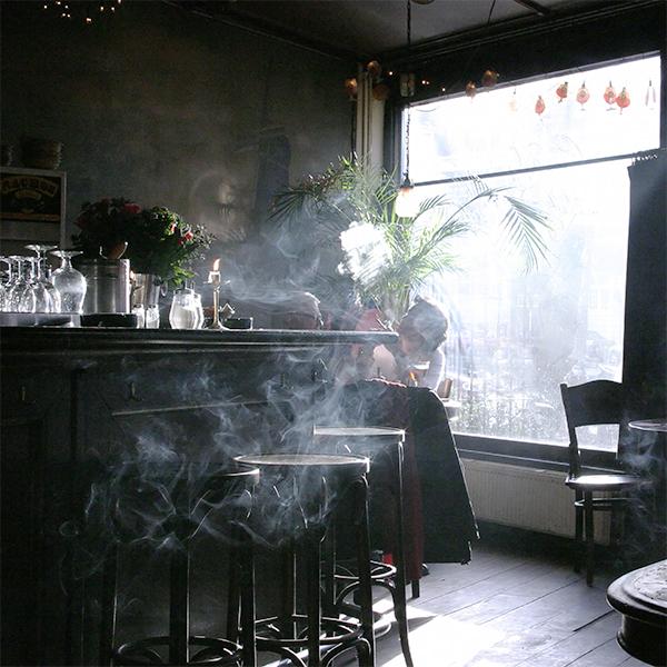 Photograph of a smoke filled bar.