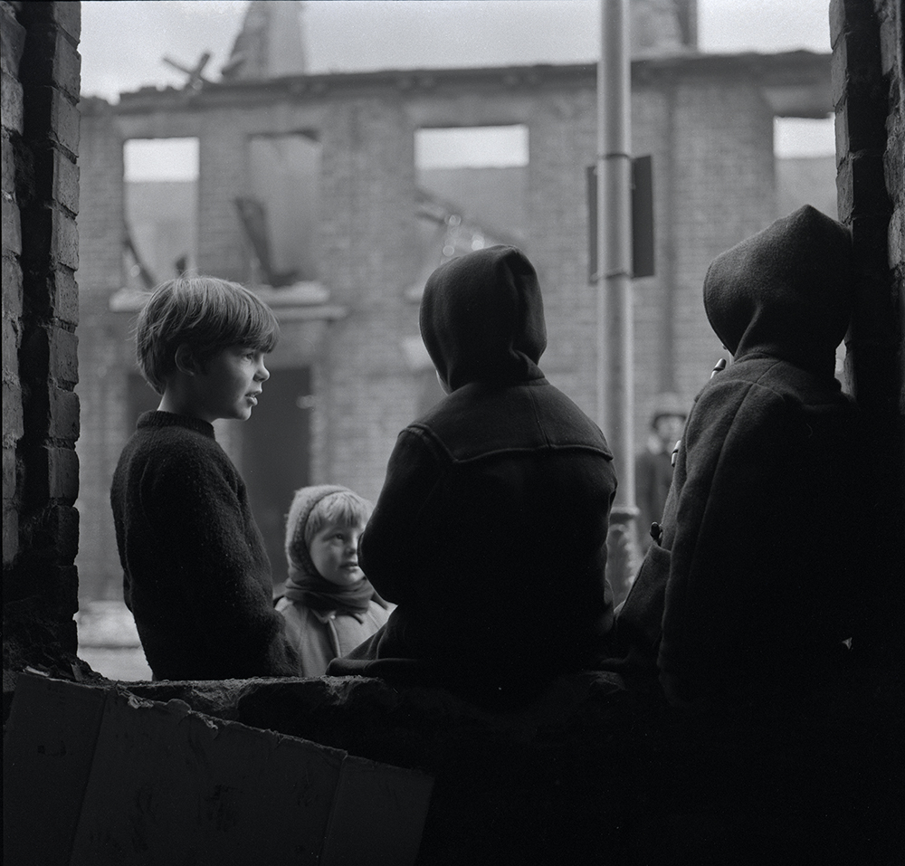 Photograph of young kids wearing duffel coats down Brighton Street Hull as it is being demolished 1973.