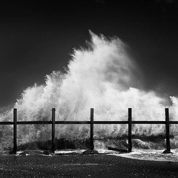 Black and white photograph of crashing waves.
