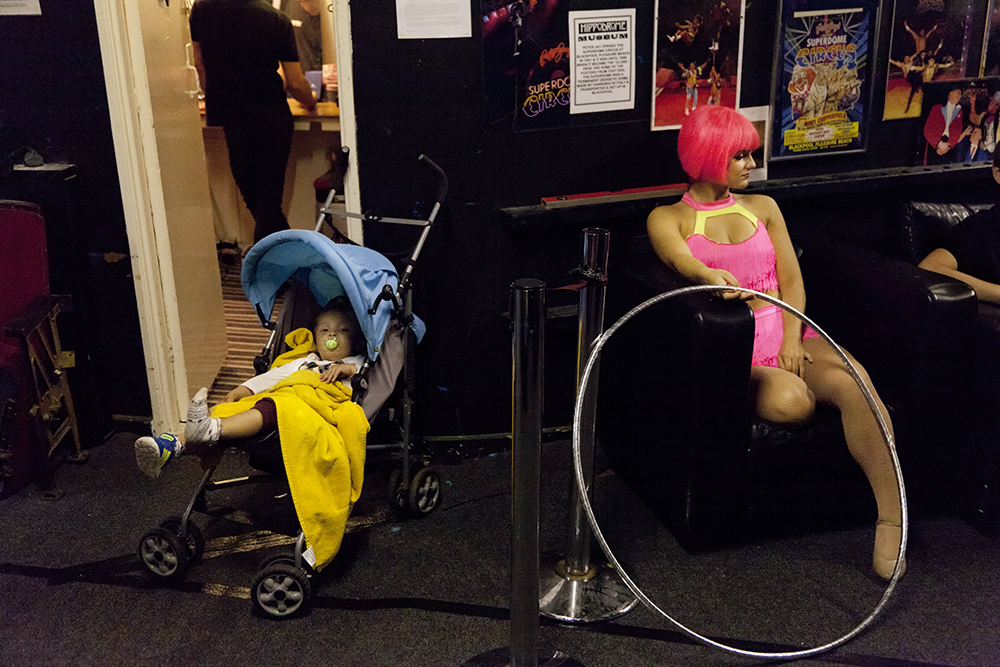 A backstage photograph at the Hippodrome Circus of a dancer and child.