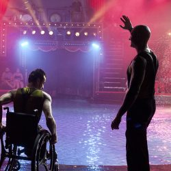 Strong men act with Alan Pagnota and Rafael Ferreria who is in a wheel chair.