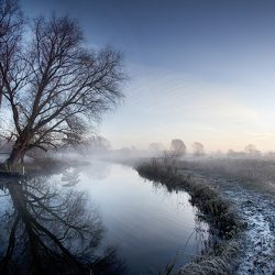 A photograph of the river Bure in an early morning frost.