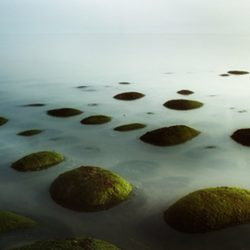 Photograph of rocks in the sea at Hunstanton.