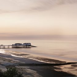 A photograph of Cromer pier and sands at the end of the day.