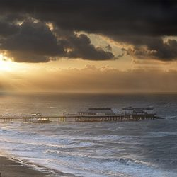 A photograph of a gathering storm over Cromer pier Norfolk.