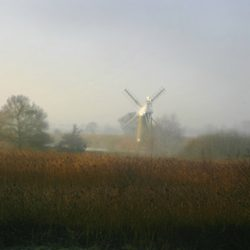 Misty early morning photograph of the wind pump at Thurne Norfolk.