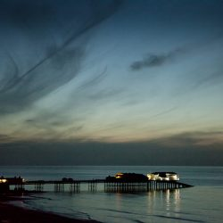 A photograph taken at dusk of the pier at Cromer Norfolk.