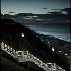 Photograph of steps down to the beach taken at dusk.