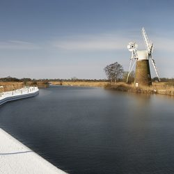 A photograph of snow on the moorings near the wind pump at Thurne.