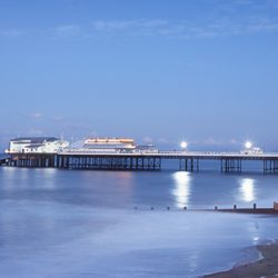 A photograph of Cromer pier at dusk.