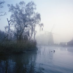 A photograph of Stalham wind pump in the mist.
