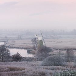 Colour photograph panorama of the wind pump and surrounding countryside at Thurne Norfolk.