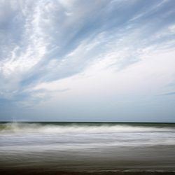 Photograph of the sea below a scudding sky on Cromer beach Norfolk.