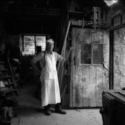Black and white photograph of a carpenter and coffin maker.