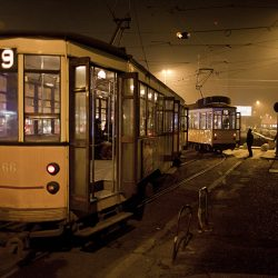 Photograph of a tram at night in Milan.