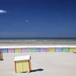 Photograph of beach huts in Normandy