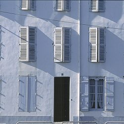 Photograph of shutters on a French villa.