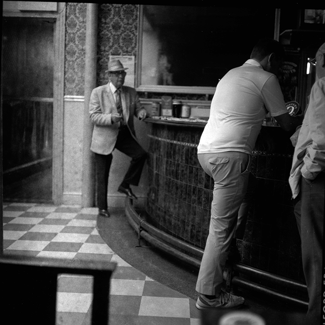 Black and white photograph of men at the bar in the King Billy pub Hull.
