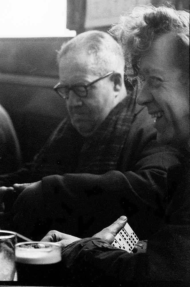 Black and white photograph of domino players in the Paragon pub Hull 1971.