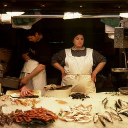 Photograph of a fishwife in Barcelona Fish Market.