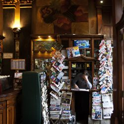 Photograph of a kiosk selling newspapers and magazines inside a bar in Lisbon.