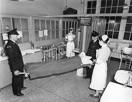 Black and white photograph of Victoria Hospital Hull showing a patient on a stretcher in the 1950's.