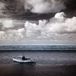 Infrared photograph of a boat on sandbanks Norfolk.