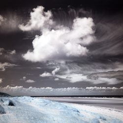 Infrared photograph of sand dunes and sky Holkham sands Norfolk.