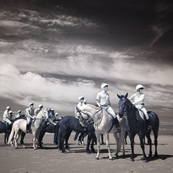 Infrared photograph of the Household Cavalry surveying the sands.